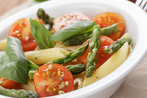 Asparagus, peas with cherry tomatoes and penne pasta