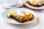 Guacamole on toast with poached eggs