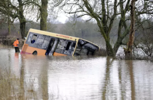School bus driver ignored two warning signs, leaving 23 children stranded in floods
