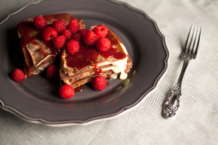 Chocolate pancakes with raspberries