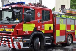 Baby coming through: Dublin Fire Brigade help deliver baby by the roadside